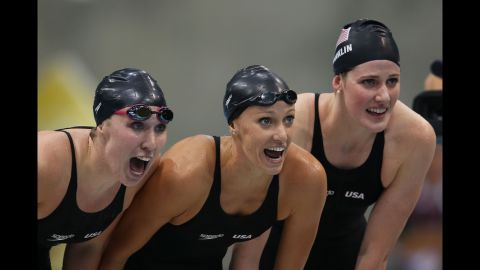 Left to right: Shannon Vreeland, Dana Vollmer and Missy Franklin of the United States encourage teammate Allison Schmitt (not pictured) as they compete in the final of the women's 4x200-meter freestyle relay.