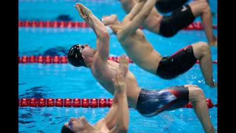 Tyler Clary of the United States pushes off of the block at the start of the second semifinal heat of the men's 200-meter backstroke.