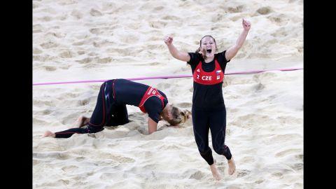 Kristyna Kolocova, right, and Marketa Slukova of the Czech Republic celebrate after winning their match against Australia during women's beach volleyball.