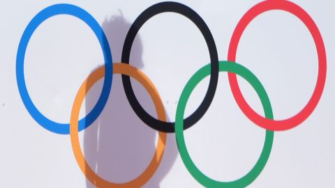 The shadow of Park Mi Hyun of Korea falls is pictured on a signage of the Olympic Rings during the women's field hockey preliminary round match between Korea and Japan at the Riverbank Arena in London on August 2, 2012 during the London 2012 Olympic Games. AFP PHOTO/ INDRANIL MUKHERJEE        (Photo credit should read INDRANIL MUKHERJEE/AFP/GettyImages)
