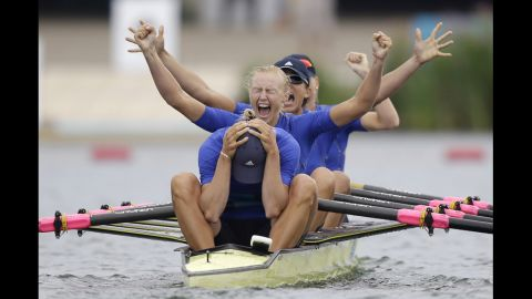 """Yana Dementieva, foreground, Anastasiia Kozhenkova, Nataliya Dovgodko, and Kateryna Tarasenko of Ukraine celebrate their win after the women's rowing quadruple sculls final in Windsor, England, on Wednesday, August 1. Check out <a href=""""http://www.cnn.com/2012/07/31/worldsport/gallery/olympics-day-four/index.html"""" target=""""_blank"""">Day 4 of competition</a> from Tuesday. The Games ran through August 12."""