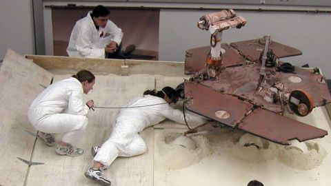 """Scott Maxwell, top, Kim Lichtenberg, left, and Pauline Hwang test how to get Spirit out of a Martian """"sand trap."""""""