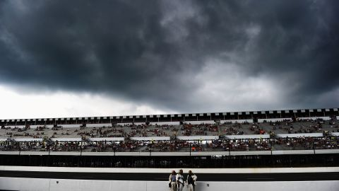 Dark clouds form over the racetrack before the start of the NASCAR Sprint Cup Series Pennsylvania 400 at Pocono Raceway.