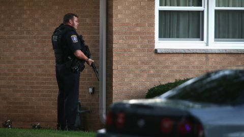 An officer works to secure a neighborhood in Cudahy, Wisconsin, on Sunday.