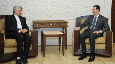 Syrian President Bashar al-Assad, right, meets with a top aide to Iran's supreme leader in Damascus on Tuesday.