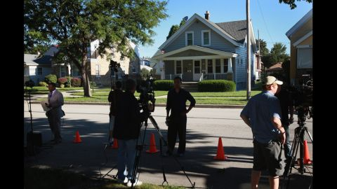 News crews report Monday from outside Page's home in Cudahy, Wisconsin.