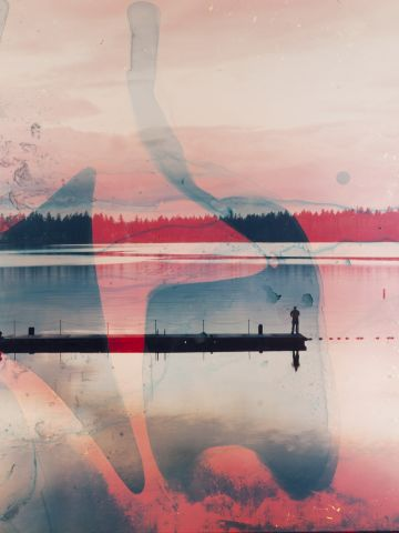 Brandt didn't know how soaking prints in lake water, like this American Lake image, would come out, but his experiementation proved to swirl the colors in a magnificent way.