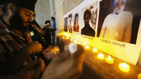 Photos of victims are seen during a candlelight vigil on Wednesday, August 8, in Union Square, New York for victims of the Wisconsin Sikh temple shooting.