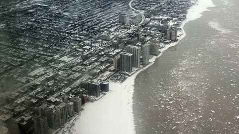 """Marvin Mason took this """"apocalyptic"""" shot of Chicago flying over Lake Michigan. """"The icy waters added to the drama."""""""