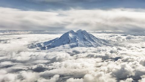 """Jonathan Dong, a student and freelance photographer, created a panoramic photo (cropped here) of Washington's Mount Rainier by laying five images horizontally. """"It was the only peak in view that was capable of rising up to bathe in the morning sun, shining in the light, but yet completely solitary."""""""