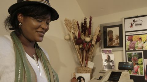 """Jan Asante in her boutique """"Gisella's,"""" in south London, which she runs with her mother Gisella Asante."""