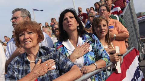 Romney supporters sing the U.S. national anthem as they wait for Romney to introduce Ryan as his vice presidential running mate.