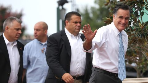 Romney waves at members of the media as he arrives at the USS Wisconsin to announce Ryan has his running mate.