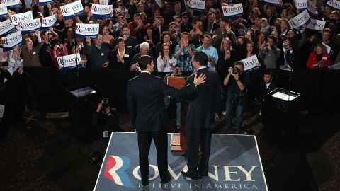Ryan, left, and Romney greet each other on stage April 3, 2012, during the primary night gathering at The Grain Exchange in Milwaukee.
