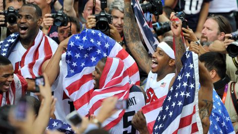 The U.S. men's basketball team celebrates winning the gold medal after defeating Spain on the final day of the London 2012 Olympics on Sunday, August 12.