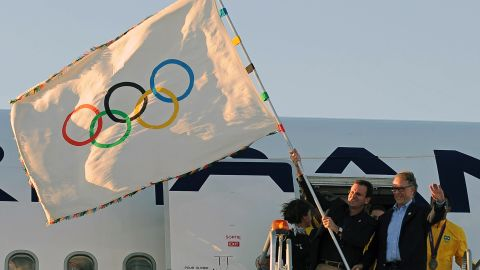 The Olympic flag arrives from the London 2012 Olympics, in Rio de Janeiro, on August 13, 2012