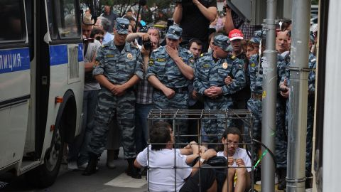 """Supporters sit locked in a mock defendants cage outside a Moscow court. The band members have been charged with hooliganism aimed at """"inciting religious hatred."""""""
