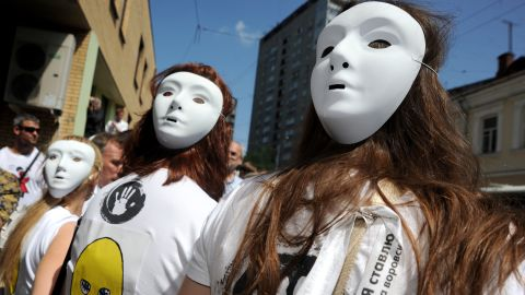 """Demonstrators wear Pussy Riot-style masks outside a Moscow court. Singer Madonna also donned one of the masks during a recent gig in the city, telling the audience: """"Everyone has the right to free speech, everywhere in the world. Maria, Katya, Nadia, I pray for you."""""""
