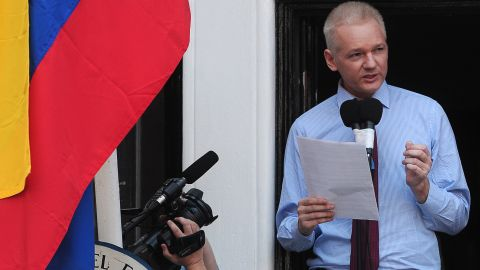 Assange addresses the media and his supporters from the balcony of the Ecuadorian Embassy in London on Sunday, August 19.