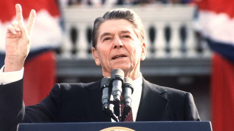 US President and Republican presidential candidate Ronald Reagan makes the V sign as he addresses supporters at an electoral meeting in November 1984, a few days before the american presidential election. (Photo credit should read DON RYPKA/AFP/Getty Images)