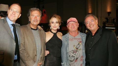 """From left, New Line's Toby Emmerich, Bob Shaye, actress Keira Knightley, director Scott and producer Samuel Hadida arrive at the premiere of """"Domino"""" in Hollywood in 2005."""