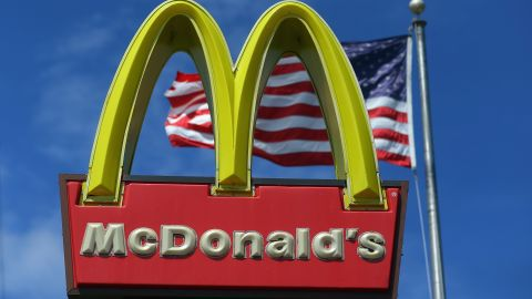A sign for a McDonald's restaurant sits in front of an American Flag July 23, 2012 in Miami, Florida. The company announced that 2nd quarter profit dropped 4.5 percent. (Photo by Joe Raedle/Getty Images)
