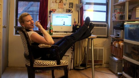"""New York City is synonymous with tiny living spaces. And for Kristen Booth, her 214-square-foot East Village studio apartment is no exception. """"Living in a small space can prove that we really don't need as much as we think we do,"""" she said. """"Rent control is a blessing and a curse!"""""""