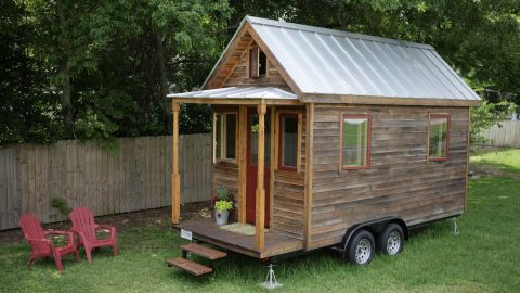 """Inspired to radically downsize once his daughters moved out of his 1,800-square-foot house, Louisiana resident Art Cormier said he doesn't miss the burden of maintaining a large space. """"I have found the small house very peaceful and relaxing,"""" he said."""