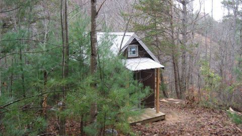 """Realizing that their 2,700-square-foot home was becoming too much of a maintenance burden, Laura M. LaVoie and her partner decided to dramatically downsize to a 120-square-foot home in a remote area of North Carolina. """"Tiny house living isn't for everyone,"""" she said. """"But living differently will profoundly change you no matter how you do it."""""""