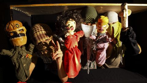 """The puppet cast of """"Top Goon: Diaries of a Little Dictator,"""" produced by anonymous Syrian artists' collective Masasit Mati. At the far right is the character representing Assad, known by the diminutive """"Beeshu."""""""