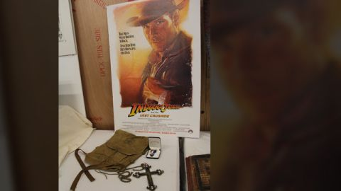 """Props from the opening sequence of """"Indiana Jones and the Last Crusade"""" -- young Indy's Boy Scout backpack, Eagle Scout ribbon and the Spanish crucifix he encounters (""""It belongs in a museum!!"""")"""