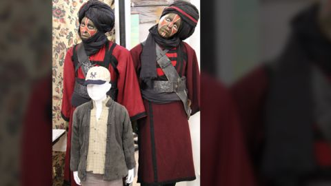 """Mannequins of two Thuggee cult members and the costume of Indy's sidekick, """"Short Round,"""" from 1984's """"Indiana Jones and the Temple of Doom."""""""