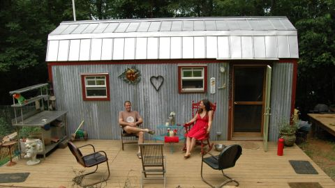 """Downsizing from a 1,500-square-foot house to a tiny 168-square-foot dwelling in Floyd, Virginia, Hari Berzins says she loves the freedom when it comes to tiny living. """"We live larger on our 3-acre hillside,"""" she said. """"We have more time to enjoy each other, tend to our large garden and cultivate a supportive community."""""""