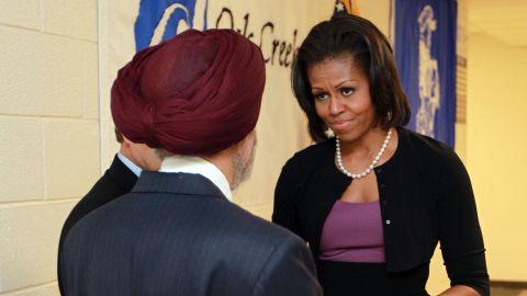 Michelle Obama greets Sikh community representative Dr. Kulwant Singh Dhaliwal on Thursday in Oak Creek, Wisconsin.