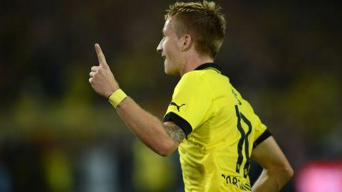 Marco Reus celebrates Borussia Dortmund's opening goal in a 2-1 win over Werder Bremen at the Westfalenstadion on Friday