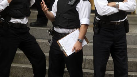 A document that says that WikiLeaks founder Julian Assange is to be arrested in any circumstances if he comes out of the Embassy of Ecuador is seen on a police officer's clipboard. (Editor's note: Part of the document has been pixelated by Press Association news agency.)