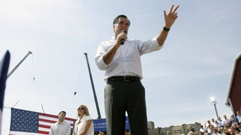 Mitt Romney, his wife Ann, and his running mate Paul Ryan, campaign together Friday in Commerce, Michigan.