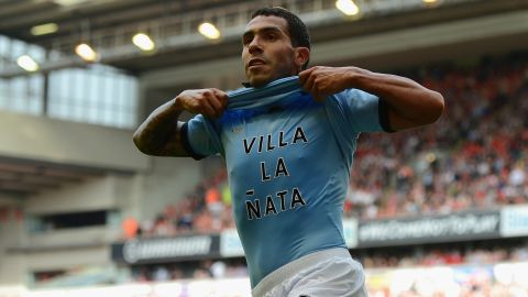 Carlos Tevez celebrates his equalizer at Anfield in Manchester City's 2-2 draw with Liverpool.