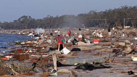 People search for their belongings among debris washed up on the beach in Biloxi on August 30, 2005.