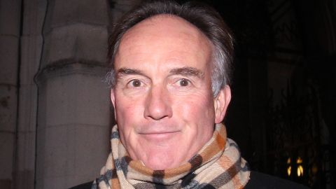 Former News International Lawyer Tom Crone leaves the Royal Courts of Justice on December 13, 2011.