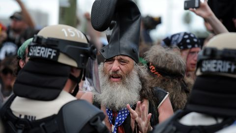 Protester Vermin Supreme talks with riot police at the Republican National Convention in Tampa on Tuesday, August 28.