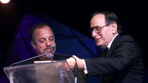 """Hal David presents the Johnny Mercer Award to Billy Joel in New York City on June 14, 2001. David wrote hit songs such as """"Raindrops Keep Falling on my Head,"""" """"This Guy's in Love With You,"""" """"I'll Never Fall in Love Again,"""" and """"What The World Needs Now is Love."""" He was chairman emeritus of the Songwriters Hall of Fame. He died at 91."""