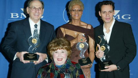 From left to right: David and singers Beverly Sills, Dionne Warwick and  Marc Anthony pose with their statues at the 2002 NARAS Heroes Awards in December 2002 in New York City.