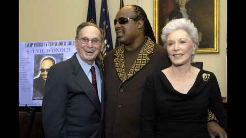 """Stevie Wonder, center, poses for a picture with the Davids in the green room during the American Society of Composers, Authors and Publishers (ASCAP) annual """"Songwriter Night"""" March 2007 in Washington."""