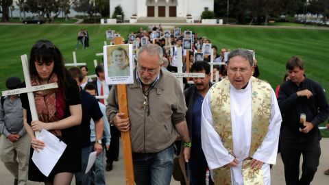 Javier Sicilia leads a 50-cross procession at Loyola Marymount University, each cross representing 1,000 cartel murder victims.