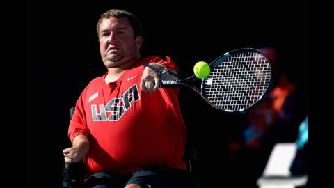 Nicholas Taylor of the United States plays a forehand in the quad doubles wheelchair tennis final on Wednesday.