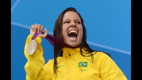 Silver medallist Edenia Garcia of Brazil poses on the podium during the medal ceremony for the women's 50m backstroke - S4 final on Thursday.