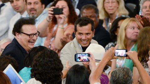 Actor John Leguizamo, center, and Wayne Knight attend the convention on Tuesday.