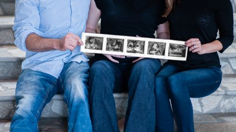 Burke and the Luciches show off photos of the babies.