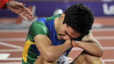 Brazil's Yohansson Nascimento breaks down on the finish line after finishing last in the men's 100-meter T46 final Thursday.